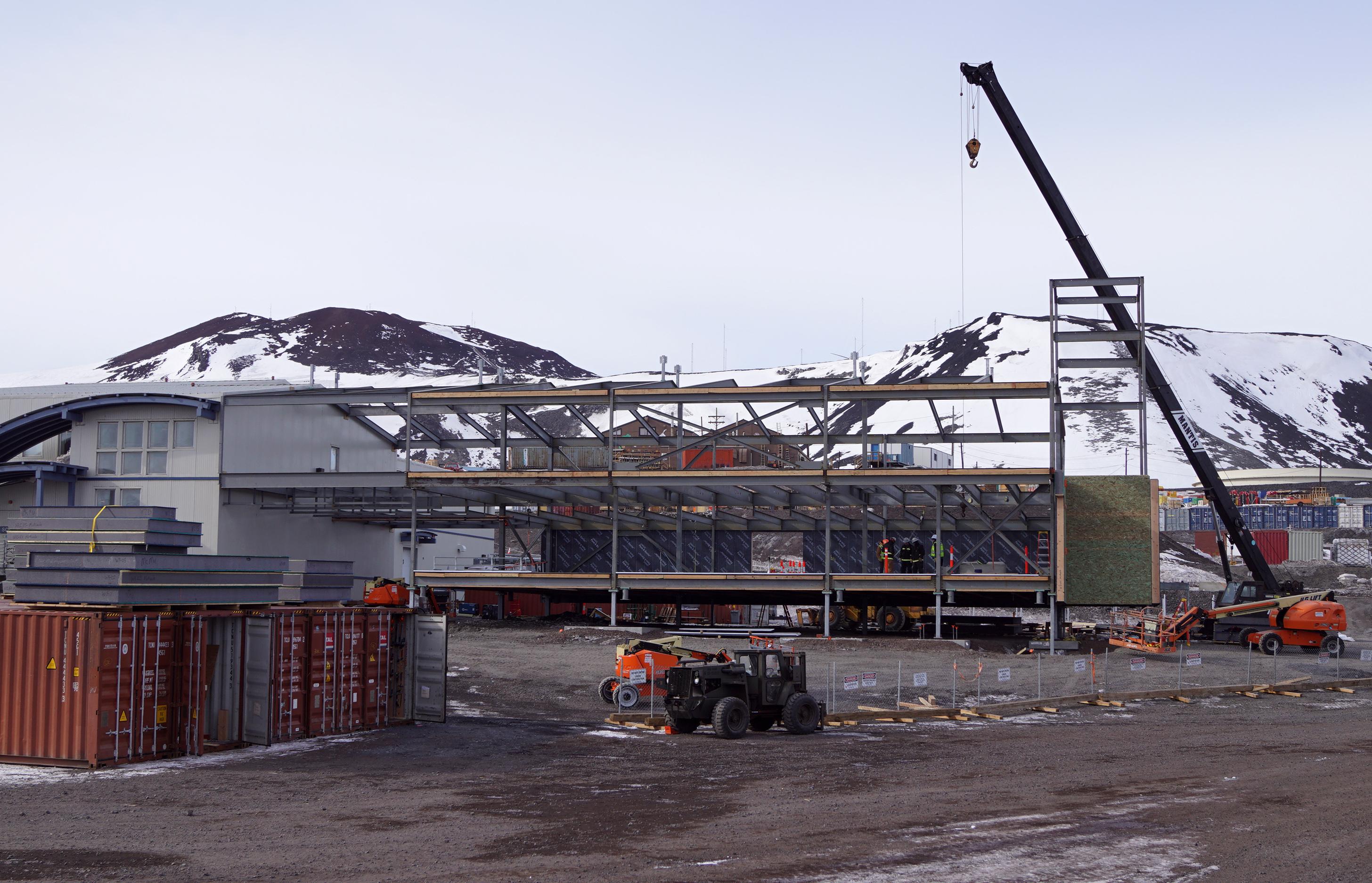 A steel beam building under construction.