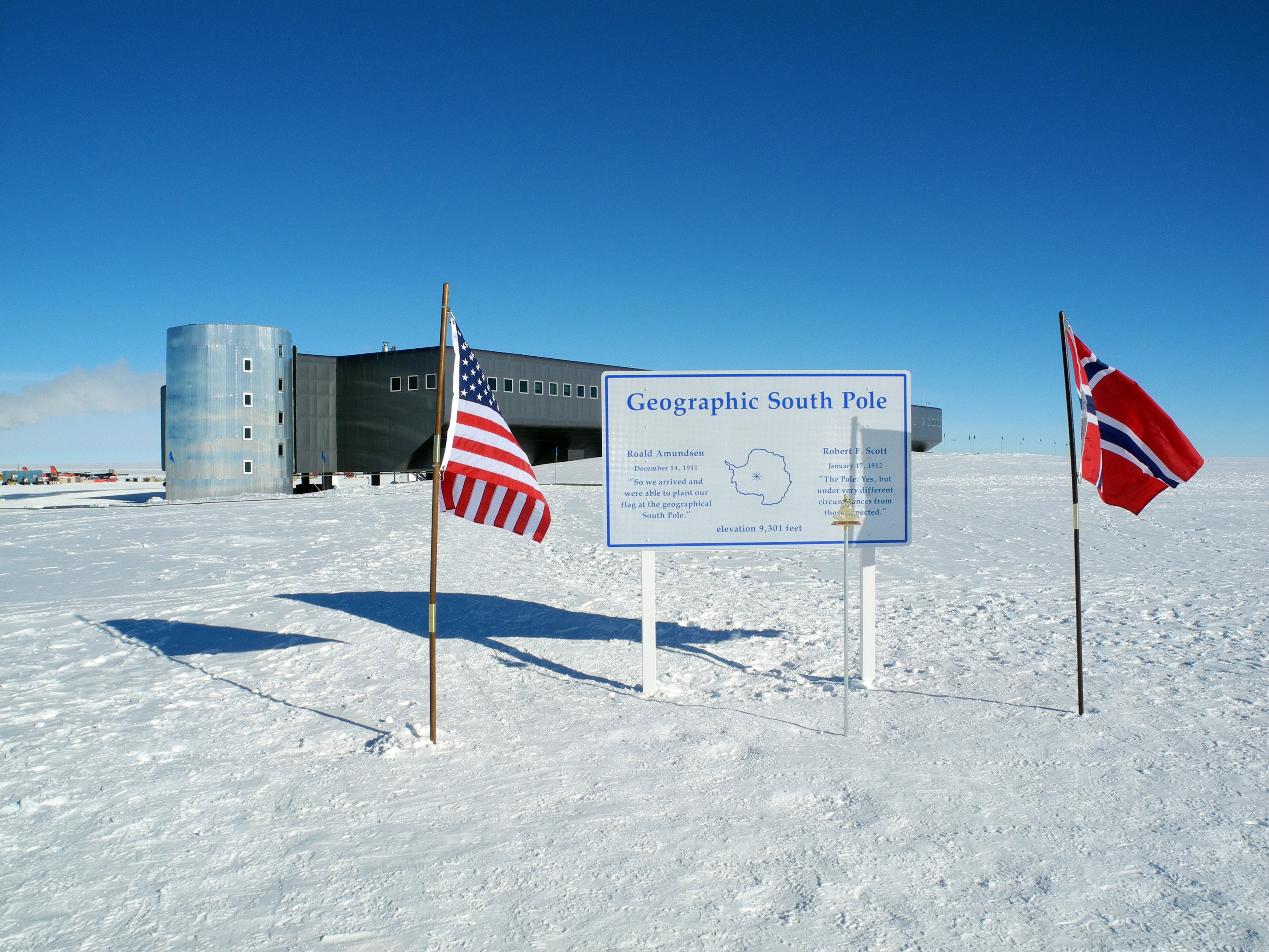 A sign with two national flags.